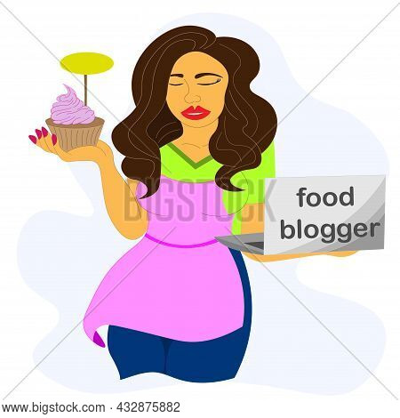 Female Blogger In An Apron Prepares Cupcake Recipe On Computer. The Girl Conducts Live Broadcast For