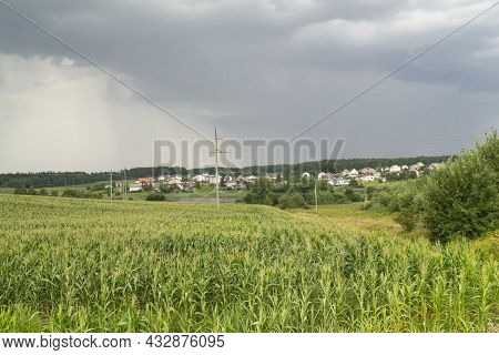 Picturesque Panoramic Scenery Of The Green Meadow And Village In Belarus. Forest In The Background.