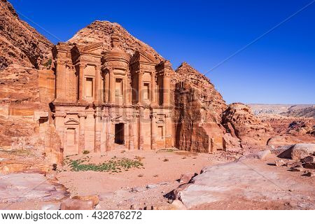 The Stunning View Of Ad Deir, The Monastery Of Petra, Jordan On A Clean Blue Sky Spring Day.