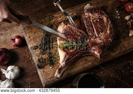 Tomahawk steak on a wooden board food photography recipe idea
