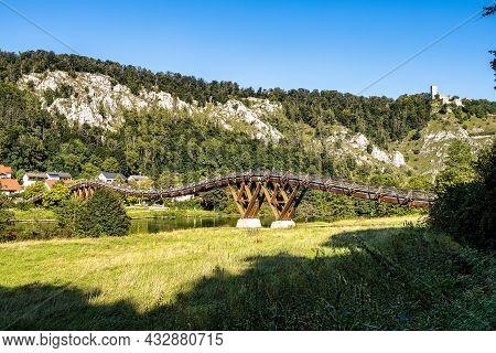 Wooden Bridge Tatzelwurm In Essing At Altmuehl River Below The Ruins Of Randeck Castle, Bavaria, Ger