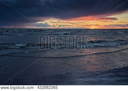 Dramatic Sunset On The Shore Of The Baltic Sea Before The Approach Of A Thunderstorm.