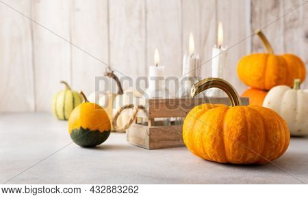 Autumn still life with pumpkins and candles on table.Thanksgiving day or halloween concept.