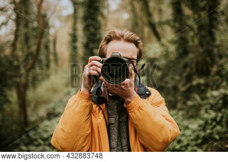 Photographer man taking a photo outdoor traveling