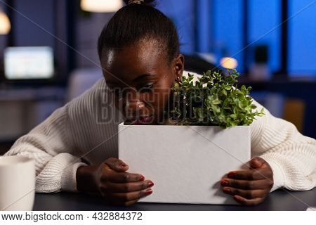 Sad Dismissed African American Businesswoman Standing With Head On Cardboard Box After Is Fired Late