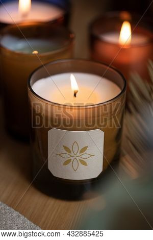 Lit aromatherapy scented candles closeup