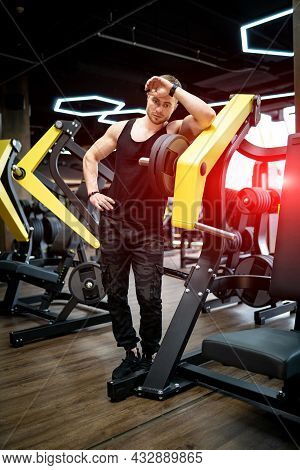 Muscular Athletic Man Training Hard. Strong Handsome Bodybuilder Working In The Gym.