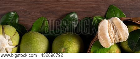 Fresh Pomelo Fruit On Dark Wooden Table Background.
