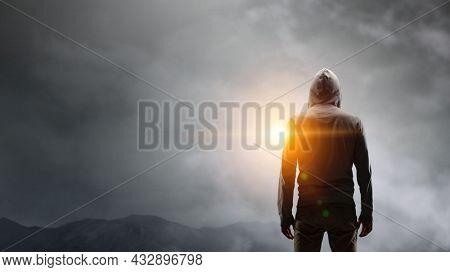 Silhouette of man in hoody. Mixed media