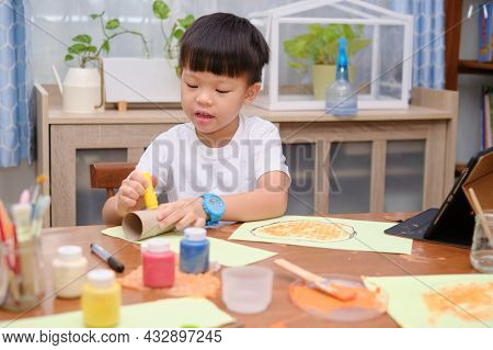 Cute Little Asian 5 Years Old Toddler Boy Enjoy Using Glue Doing Arts At Home, Fun Paper And Glue Cr