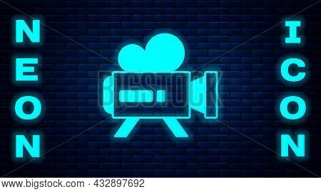 Glowing Neon Retro Cinema Camera Icon Isolated On Brick Wall Background. Video Camera. Movie Sign. F