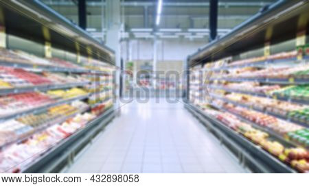 Abstract Blur Image Of Supermarket Background. Defocused Shelves With Fresh Products. Grocery Shoppi
