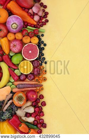 Immune system boosting healthy fresh vegan food. Health foods high in fibre, antioxidants, plant sterols, anthocyanins, smart carbs, lycopene, carotendoids,vitamin c. Background on mottled yellow.