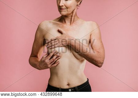 Elderly woman being aware of breast cancer