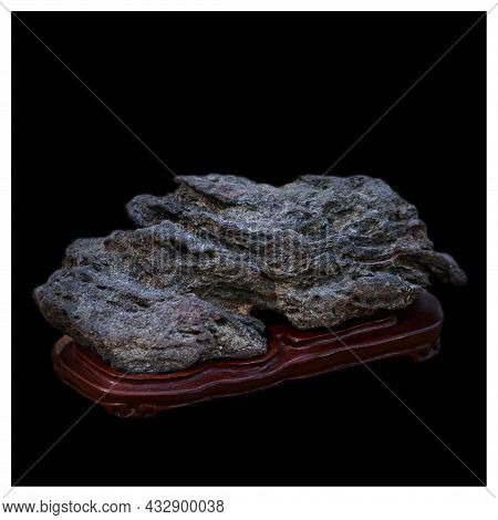 Natural Stone Of Unusual Shape. A Decorative Element In The Interior. Suiseki, Naturalness And Minim