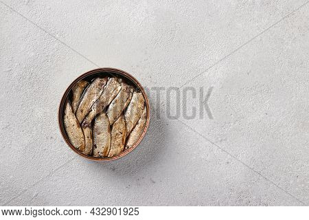 Baltic Sprats In An Tin Can On A Light Gray Background. Top View. Copy Space
