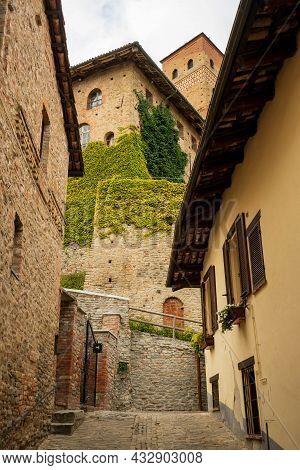 Narrow Street With Castle View Of Serralunga D'alba, Piemonte, Langhe Wine District And Unesco Herit