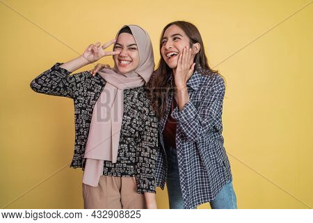 A Woman With Long Hair Laughs Happily And A Woman In Veil Beside Her Laughs With Finger Gestures Pea
