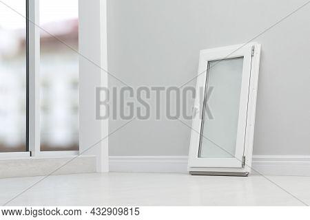 Modern Single Casement Window Near Light Grey Wall Indoors, Space For Text