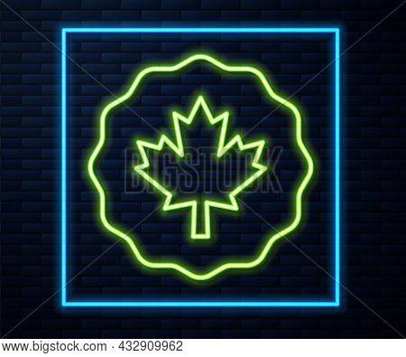 Glowing Neon Line Canadian Maple Leaf Icon Isolated On Brick Wall Background. Canada Symbol Maple Le