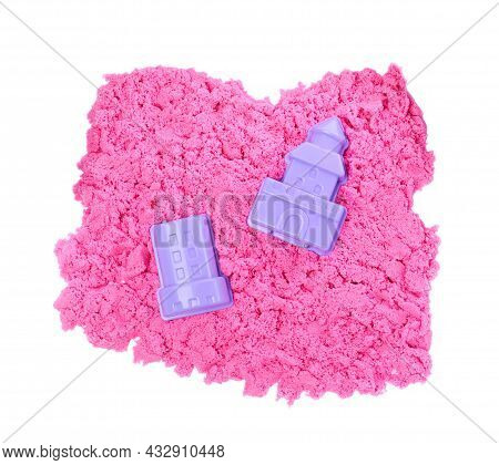 Pink Kinetic Sand And Toys On White Background, Top View