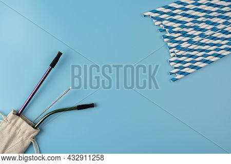 Different Material Drinking Straws On Pastel Blue Background. Paper And Eco Friendly Plastic Free St