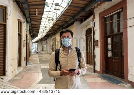 Masked Male Tourist Walks At Closed Market During Coronavirus Pandemic, Lockdown On Cyprus. Man In M