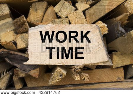 Wall Firewood. Background Of Dry Chopped Firewood Logs In A Pile And Plate With Text Work Time. Conc