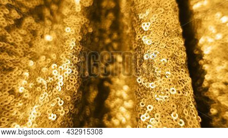Holiday Background From Golden Glitter Sequins With Depth Of Field. Metallic Bright Close Up Sparkli
