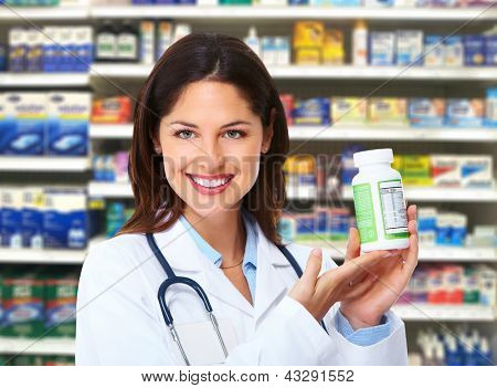 Medical pharmacist woman at drugstore. Health care background.