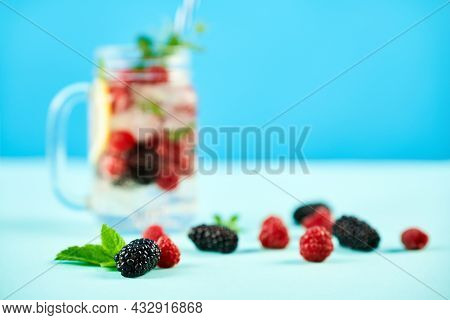 Fresh Berries Cocktail In Glass Jar. Party, Drink, Summer Concept
