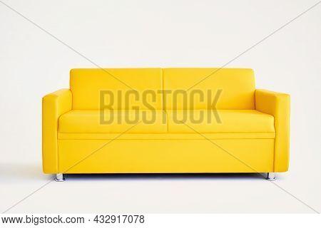 Comfortable Bright Yellow Sofa On White Background