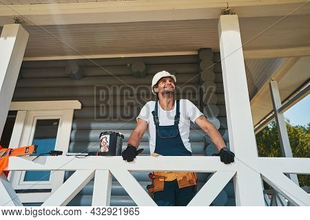 Civil Engineer Checking Ceiling Of House Porch