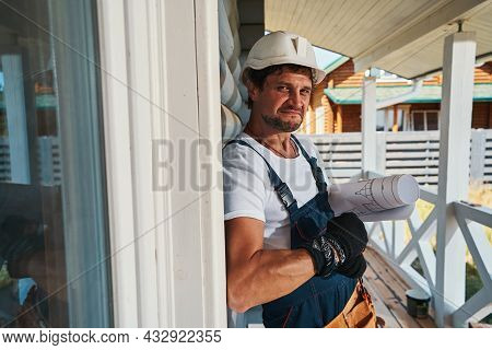 Unhappy Worker Looking At Camera While Resting On Porch