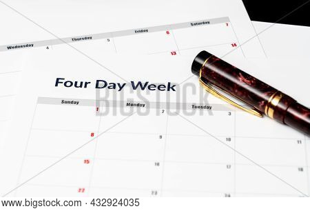 Printed Calendar For A 4 Day Working Week Showing Weekend Days In Red In New Approach To Productivit