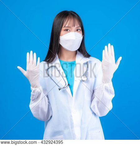 Female Doctor Woman Wearing White Medical Gown Sterile Face Mask Gloves And Rubber Gloves With Steth