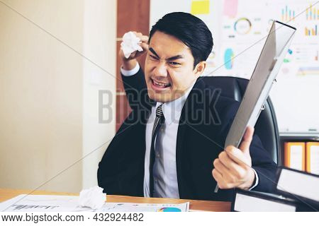 Business Man Wearing A In The Office He Was Angry , Furious He Threw Away The Crumpled Paper Documen