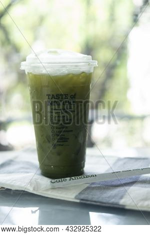Bangkok, Thailand - September 14, 2021 : A Glass Of Iced Green Tea From Cafe Amazon Are Found In Eve