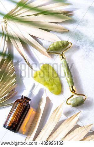 Cosmetic Products Bottle Oil, Face Roller And Gua Sha Massager. Top View. Spa Relax, Body Treatment,