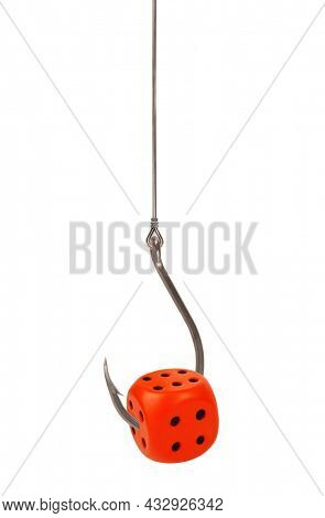Fishing hook with dice symbolizes gambling problem isolated on white background. Addiction catching concept. Prepared decoy for being hooked to gamble and become addict