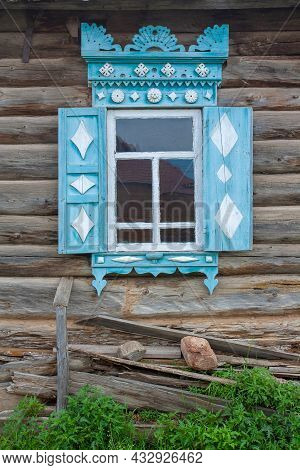 Old Russian Carved Window Shutters In Log House. Vertical Image.