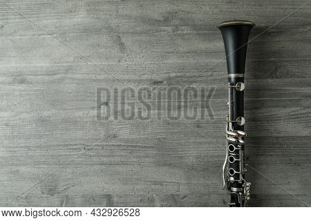 Clarinet On Gray Textured Table, Space For Text