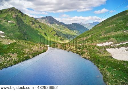 Aerial beautiful summer landscape of Caucasus mountain. Dukka lakes near Arkhyz village in Russia. Daylight mountain landscape.