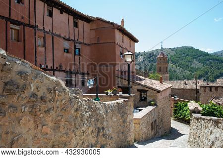 Beautiful Traditional Buildings At Albarracin, Surrounded By Mountains. Sunny Day, No People. Teruel