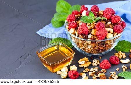 A Portion Of Crispy Granola With Fresh Berries And Honey On A Dark Background. Healthy Breakfast Con
