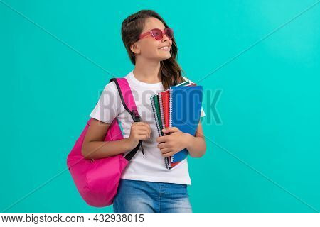 Kid In Glasses Hold Copybook. September 1. Childhood. Student Child With School Bag