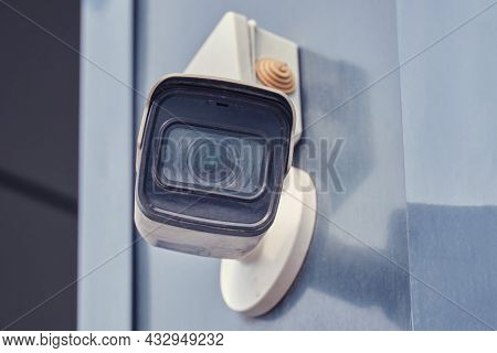 Video Surveillance Camera On The Building, Monitoring The Security Of A Residential House