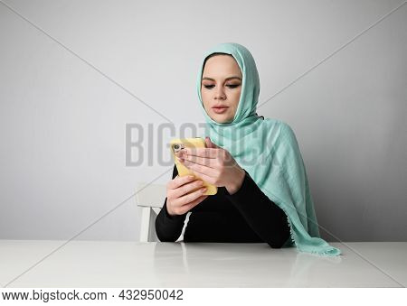 Arabian Woman With Happy Smile Using Smartphone, Isolated On White Wall.