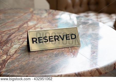 Metal Plaque With The Inscription Reserved On The Restaurant Stone Table.reserved Sign With Capital