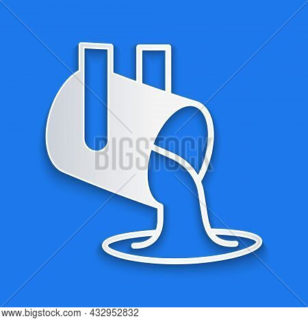 Paper Cut Molten Gold Being Poured Icon Isolated On Blue Background. Molten Metal Poured From Ladle.